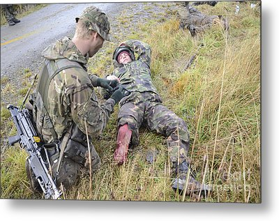 A Patrol Medic Applies First Aid Metal Print by Andrew Chittock