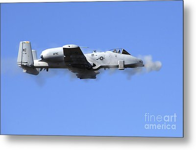 A Pilot In An A-10 Thunderbolt II Fires Metal Print by Stocktrek Images
