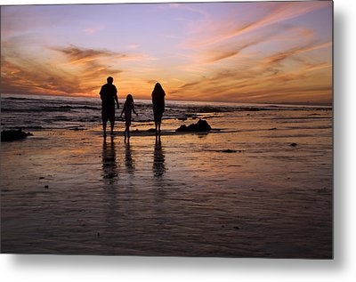 A Rear View Of A Family With One Child Metal Print by James Forte