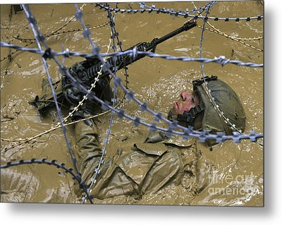 A Soldier Back Crawls Through A Pit Metal Print by Stocktrek Images