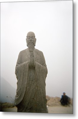 A Statue Of A Buddhist Monk In China Metal Print by Justin Guariglia