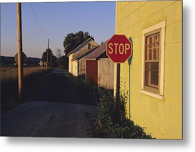 A Stop Sign In A Rural Alley Metal Print by Raymond Gehman