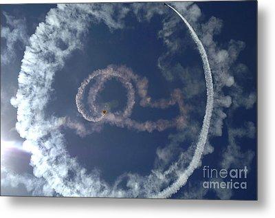 A Stunt Plane Flies Metal Print by Stocktrek Images