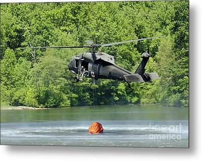 A Uh-60 Blackhawk Helicopter Fills Metal Print by Stocktrek Images
