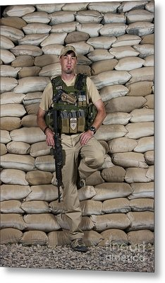 A U.s. Police Officer Contractor Leans Metal Print by Terry Moore
