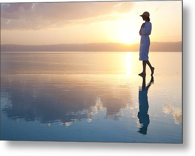 A Woman Enjoys The Warm Sun On The Edge Metal Print by Taylor S. Kennedy