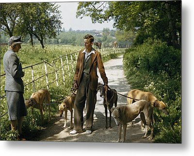 A Woman Talks With A Man Walking Racing Metal Print by B. Anthony Stewart