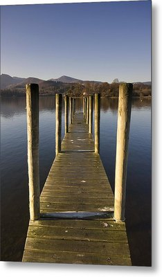 A Wooden Dock Going Into The Lake Metal Print by John Short
