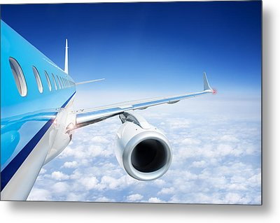 Airliner In Flight Above The Clouds Metal Print by Corepics