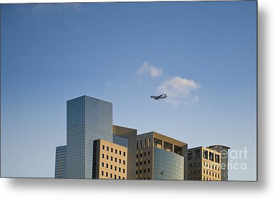 Airplane Flying Over Office Buildings Metal Print by Noam Armonn