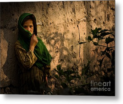 An Afghan Girl Covers Her Face Metal Print by Stocktrek Images