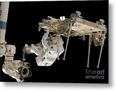 An Astronaut With His Feet Secured Metal Print by Stocktrek Images