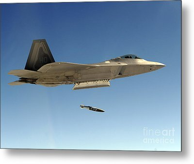 An F-22a Raptor Drops A Gbu-32 Bomb Metal Print by Stocktrek Images