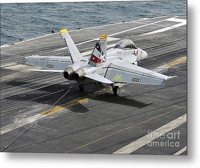 An Fa-18f Super Hornet Traps An Metal Print by Stocktrek Images