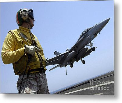 An Officer Observes An Fa-18f Super Metal Print by Stocktrek Images