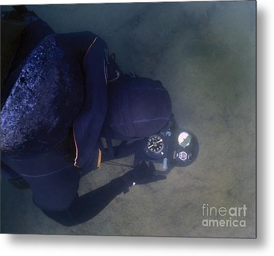 An Over The Shoulder View Of A Navy Metal Print by Michael Wood