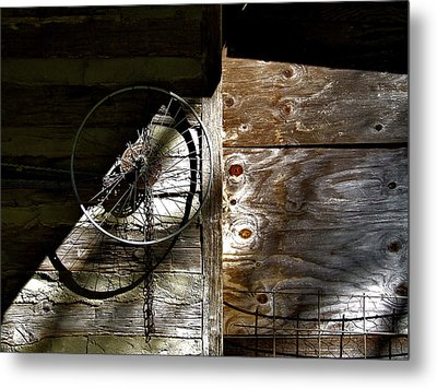 Bicycle Wheel On Wall Metal Print by Richard Gregurich