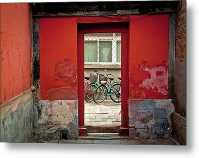 Bicycles In Red Doorway Metal Print by photo by Sharon Drummond