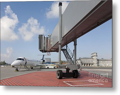 Boarding Bridge Leading To A Parked Plane Metal Print by Jaak Nilson