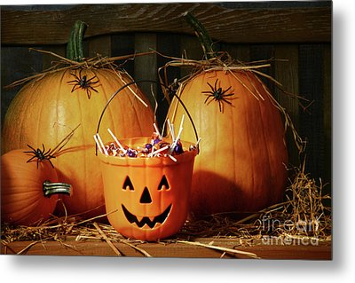 Bucket Filled With Halloween Candy Metal Print by Sandra Cunningham