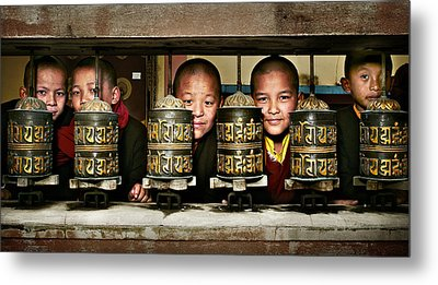 Buddhist Monks In Red Robes Look Out Of The Prayer Wheels With M Metal Print by Max Drukpa