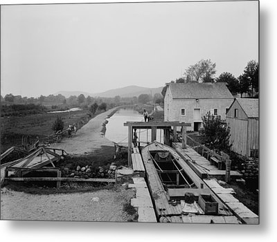 Canal Boat Passing Through A Lock Metal Print by Everett