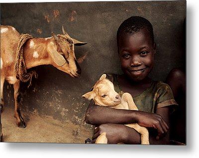 Child Holding A Kid Metal Print by Mauro Fermariello