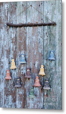 Clay Bells On A Weathered Door Metal Print by Jeremy Woodhouse