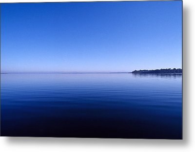 Clear Blue Sky Reflected In A Still Metal Print by Jason Edwards
