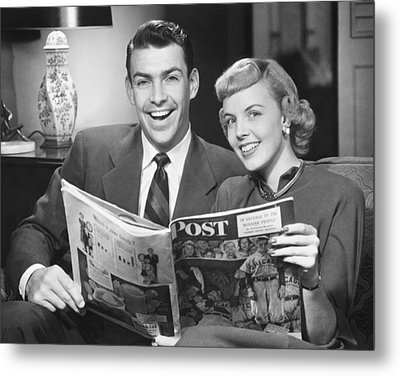 Couple Sitting On Sofa, Holding Magazine, (b&w), Portrait Metal Print by George Marks