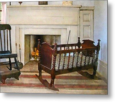 Cradle Near Fireplace Metal Print by Susan Savad