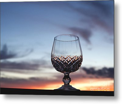 Crystal Glass Against Sunset Metal Print by Blink Images