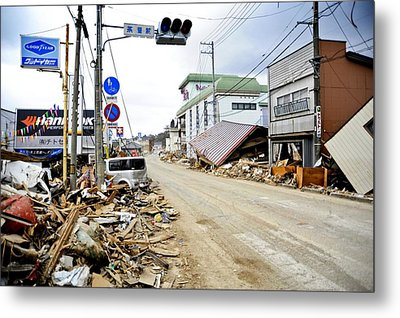 Debris Rubble And Damaged Vehicles Line Metal Print by Everett
