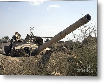 Destroyed Iraqi Tanks Near Camp Slayer Metal Print by Terry Moore