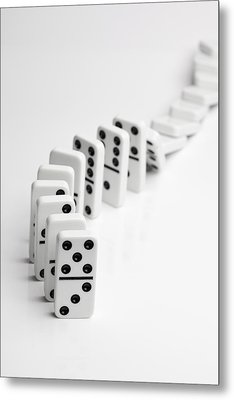 Dominoes Falling Over In A Chain Reaction Metal Print by Larry Washburn