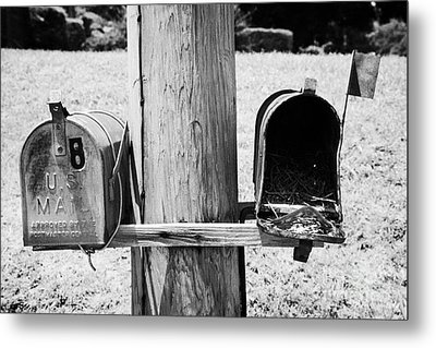 empty old used american private mailboxes one with birdsnest in Lynchburg tennessee usa Metal Print by Joe Fox