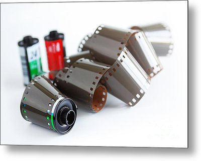Film And Canisters Metal Print by Carlos Caetano