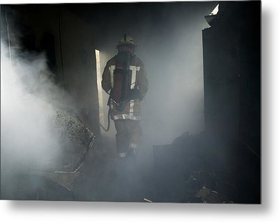 Fire Fighter In A Burnt House Metal Print by Michael Donne