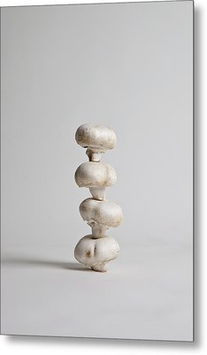 Four Mushrooms Arranged In A Stack, Studio Shot Metal Print by Halfdark