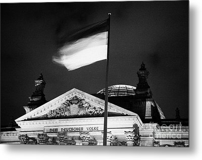 german flag flying fluttering on flagpole outside reichstag building Berlin Germany Metal Print by Joe Fox