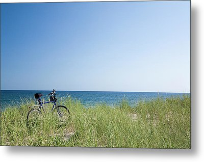 Grass Covering Bicycle Parked On Beach Dune. Metal Print by Alberto Coto