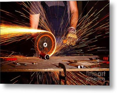 Grinder In Action Metal Print by Gualtiero Boffi