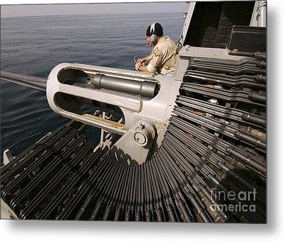 Gunner Manning A Mk-38 25mm Heavy Metal Print by Stocktrek Images
