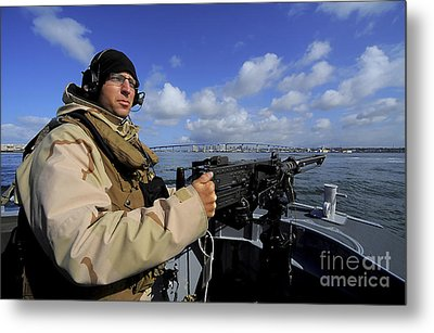Gunners Mate Mans An M2 Hb .50-caliber Metal Print by Stocktrek Images