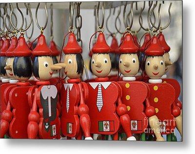 Hanging Pinocchios Puppets Metal Print by Sami Sarkis