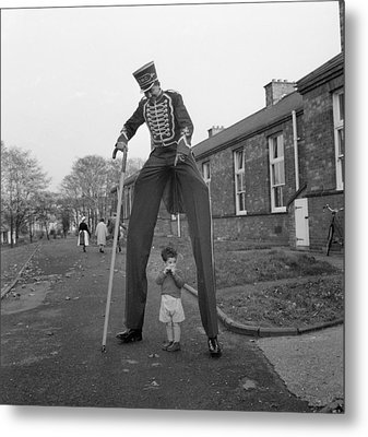 Henry The Stilt Man Metal Print by John Drysdale