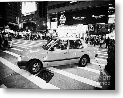 Hong Kong Red Taxi At Night On Nathan Road Downtown Kowloon Hong Kong Hksar China Metal Print by Joe Fox