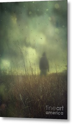 Hooded Man Walking In Field With Storm Clouds Metal Print by Sandra Cunningham