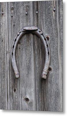 Horseshoe Hanging On A Wooden Wall Iron Metal Print by David Chapman