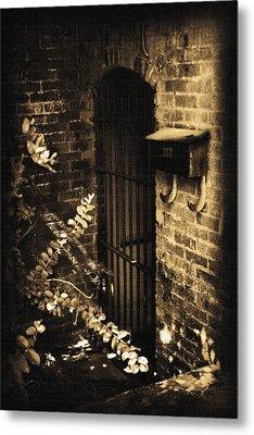 Iron Door Sepia Metal Print by Kelly Hazel